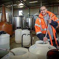 Lark Distillery master distiller Chris Thompson agitates a distilling run at Lark Distillery in Hobart, Tasmania, August 25, 2015. Gary He/DRAMBOX MEDIA LIBRARY