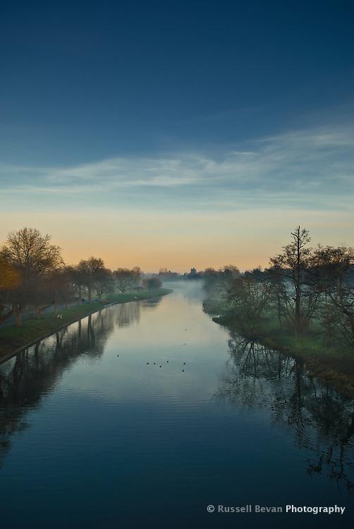View of the River Avon at dusk from the Banbury Road Bridge, Warwick, Warwickshire, England, UK