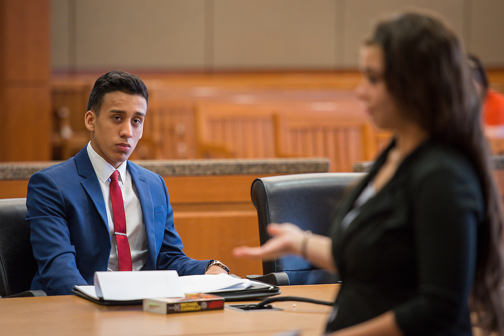 Reagan High School student Giovanni Perez-Soto participates in a mock trail at the Harris County Civil Courthouse, July 30, 2014.