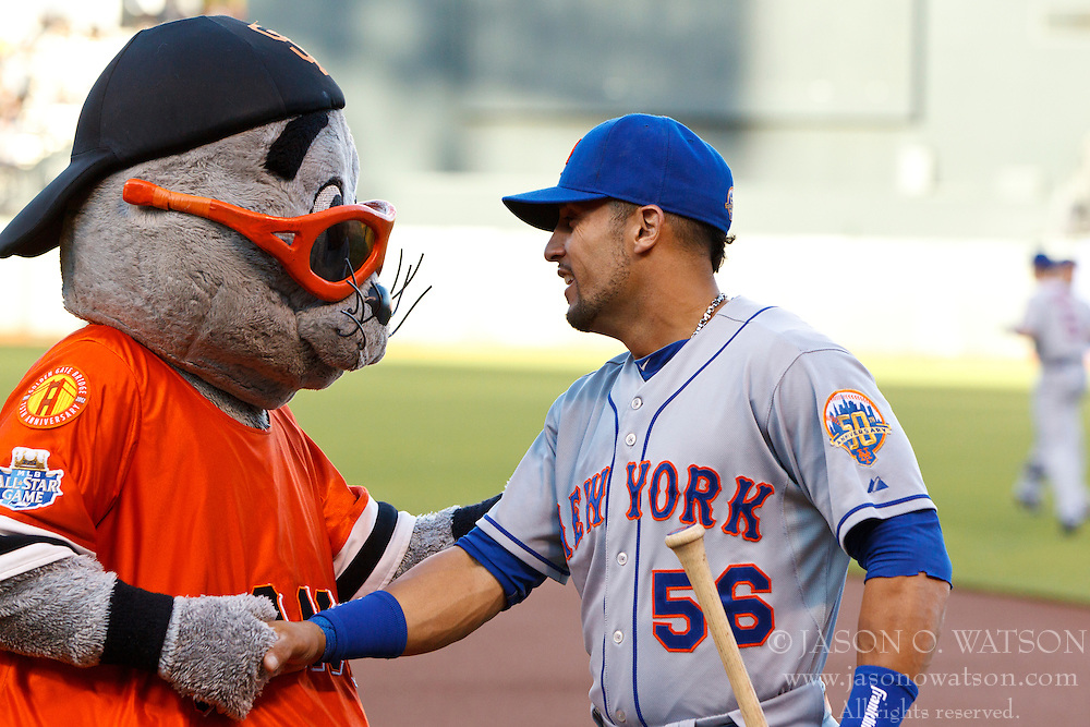 SAN FRANCISCO, CA - JULY 30:  Andres Torres #56 of the New York Mets shakes hands with the San Francisco Giants mascot Lou Seal before the game at AT&T Park on July 30, 2012 in San Francisco, California. The New York Mets defeated the San Francisco Giants 8-7 in 10 innings. (Photo by Jason O. Watson/Getty Images) *** Local Caption *** Andres Torres