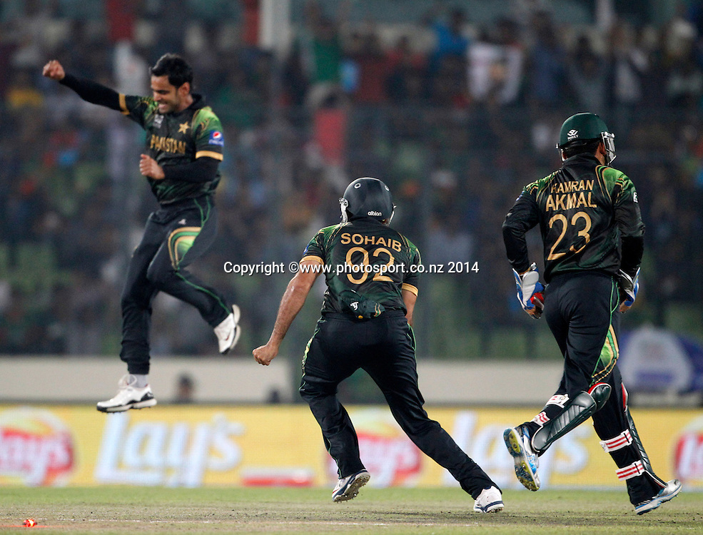 Pakistan team celebrate wicket of Chris Gayle - Pakistan v West Indies, Shere Bangla National Stadium, Mirpur, Bangladesh. 1 April 2014. Photo: www.photosport.co.nz