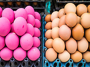 11 MARCH 2013 - LUANG PRABANG, LAOS:  Eggs for sale in the market in Luang Prabang, Laos. The pink eggs on the right are chicken eggs, called kai yo ma, which means 'horse eggs.' is that they are made in soil and straw ashes that has been wetted with horse urine.   PHOTO BY JACK KURTZ