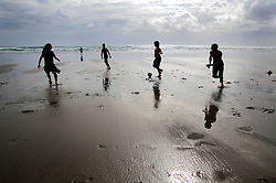 NEW ZEALAND PIHA BEACH 12DEC07 - Boys play football on Piha Beach, West Coast of northern Island, New Zealand...jre/Photo by Jiri Rezac..© Jiri Rezac 2007..Contact: +44 (0) 7050 110 417.Mobile:  +44 (0) 7801 337 683.Office:  +44 (0) 20 8968 9635..Email:   jiri@jirirezac.com.Web:    www.jirirezac.com..© All images Jiri Rezac 2007 - All rights reserved.