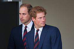 Queen Elizabeth Olympic Park, London, September 10th 2014. Prince William and Prince Harry await the arrival of their father HRH Prince Charles ahead of the opening ceremony for the Invictus Games, where over 400 competitors from 13 nations will take part in an international sporting event for wounded, injured and sick Servicemen and women.