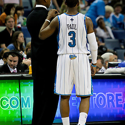 12 April 2009: New Orleans Hornets guard Chris Paul (3) and head coach Byron Scott talk during a 102-92 victory by the New Orleans Hornets over the Dallas Mavericks on Easter Sunday at the New Orleans Arena in New Orleans, Louisiana.
