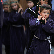 Children penitents carry a figure representing a baby Jesus the Nazarene as they parade during the Maundy Thursday procession on April 17, 2014 in the northern Spanish Basque village of Segura.  PHOTO/ RAFA RIVAS