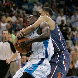 Apr 07, 2010; New Orleans, LA, USA; New Orleans Hornets guard Darren Collison (2) is fouled by Charlotte Bobcats guard D.J. Augustin (14) during the second half at the New Orleans Arena. The Bobcats defeated the Hornets 104-103. Mandatory Credit: Derick E. Hingle-US PRESSWIRE