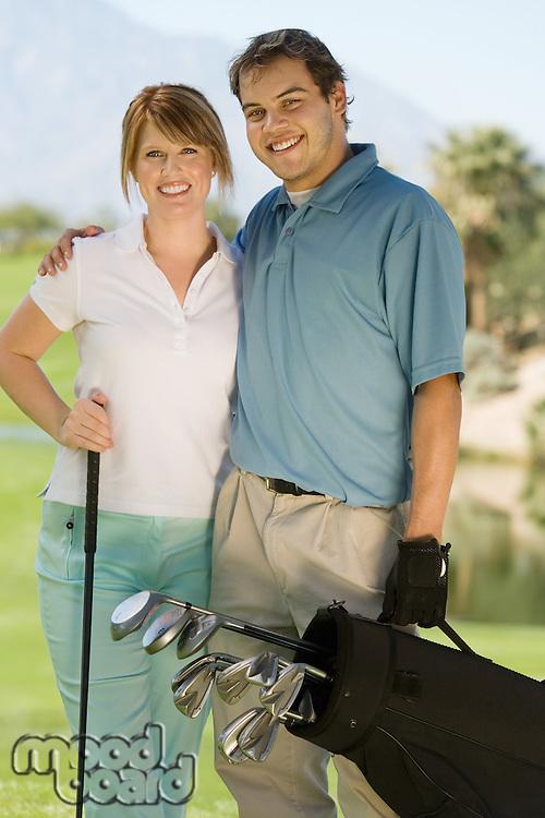 Golfing Couple Standing on Fairway