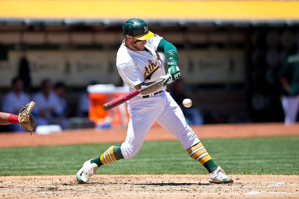 OAKLAND, CA - JUNE 21:  Brett Lawrie #15 of the Oakland Athletics hits a double against the Los Angeles Angels of Anaheim during the second inning at O.co Coliseum on June 21, 2015 in Oakland, California. (Photo by Jason O. Watson/Getty Images) *** Local Caption *** Brett Lawrie