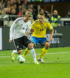 15.10.2013, Friends Arena, Stockholm, SWE, FIFA WM Qualifikation, Schweden vs Deutschland, Gruppe C, im Bild , Sverige 17 Pierre Bengtsson i duell med/ battles for the ballGermany 9 Andr� Sch�rrle Schurrle // during the FIFA World Cup Qualifier Group C Match between Sweden and Germany at the Friends Arena, Stockholm, Sweden on 2013/10/15. EXPA Pictures � 2013, PhotoCredit: EXPA/ PicAgency Skycam/ Peter Werner<br /> <br /> ***** ATTENTION - OUT OF SWE *****