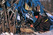 Darkhad woman & Ovoo<br /> Lighting incense<br /> Darkhad Depression<br /> Northern Mongolia
