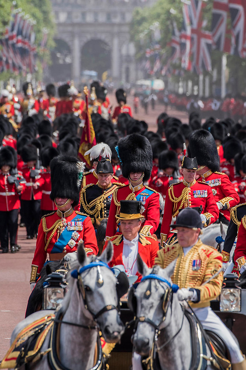 "The queens party returns down the Mall - Trooping the Colour by the Irish Guards on the Queen's Birthday Parade. The Queen's Colour is ""Trooped"" in front of Her Majesty The Queen and all the Royal Colonels.  His Royal Highness The Duke of Cambridge takes the Colonel's Review for the first time on Horse Guards Parade riding his horse Wellesley. The Irish Guards are led out by their famous wolfhound mascot Domhnall and more than one thousand Household Division soldiers perform their ceremonial duty. The Soldiers will parade in the traditional ceremonial uniforms of the Household Cavalry, Royal Horse Artillery, and Foot Guards. They are accompanied by the Household Division Bands & Corps of Drums. London 17th June 2017."