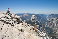 Hiker enjoying the view from the top of Cloud's Rest, Yosemite National Park