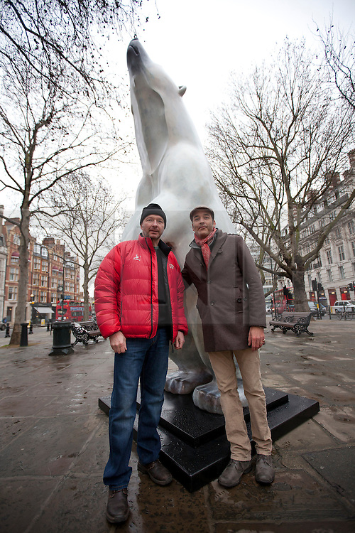 © Licensed to London News Pictures. 14/01/2013. London, UK. Polar explorer Jim McNeill (L), artist Adam Binder (C) are seen next to a bronze polar bear statue called 'Boris' in Sloane Square in London today (14/01/12).  The sculpture by Adam Binder, 12 foot tall, weighing 700 kilograms, and on display for the next 28 days, was placed in Sloane Square to launch an urgent 28 day campaign calling for a ban on the killing of polar bears for their body parts.  Photo credit: Matt Cetti-Roberts/LNP