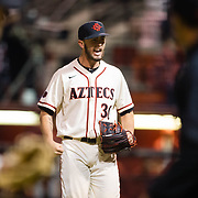 24 February 2018: The San Diego State Aztec baseball team competes in day two of the Tony Gwynn legacy tournament against #4 Arkansas. San Diego State Aztecs pitcher Daniel Ritcheson (30) pitches out of a base loaded jam in the top of the seventh in a 2-2 tie game. The Aztecs dropped a close game to the Razorbacks 4-2. <br /> More game action at sdsuaztecphotos.com
