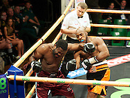 Picture by Alan Stanford/Focus Images Ltd +44 7915 056117<br /> 14/11/2013<br /> Ben Ileyemi and Moses Matovu during their cruiserweight contest at York Hall, Bethnal Green.