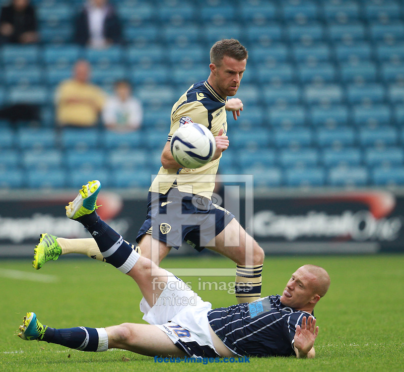 Picture by John Rainford/Focus Images Ltd +44 7506 538356<br /> 28/09/2013<br /> Nicky Bailey of Millwall and Jason Pearce of Leeds United during the Sky Bet Championship match at The Den, London.