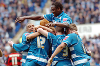 Photo: Kevin Poolman.<br /> Reading v Queens Park Rangers. Coca Cola Championship. 30/04/2006. Reading's Ibrahima Sonko jumps on Dave Kitson and other players to celebrate their first goal.