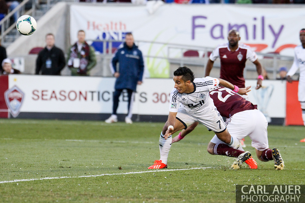 October 19th, 2013:  Vancouver Whitecaps FC forward Camilo Sanvezzo (7) gets tied up with Colorado Rapids midfielder Shane O'Neill (27) in the second half of action in the MLS Soccer Match between the Vancouver Whitecaps FC and the Colorado Rapids at Dick's Sporting Goods Park in Commerce City, Colorado