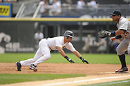 CHICAGO - JULY 27:  Omar Vizquel #11 of the Chicago White Sox dives back safely to first base during the game against Detroit Tigers on July 27, 2011 at U.S. Cellular Field in Chicago, Illinois.  The White Sox defeated the Tigers 2-1.  (Photo by Ron Vesely)  Subject: Omar Vizquel