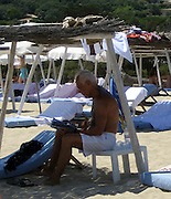 **EXCLUSIVE**.Giorgio Armani reading a magazine on the Beach in St. Stropez, France..Friday, July 20, 2007.Photo By Celebrityvibe.com.To license this image please call (212) 410 5354; or.Email: celebrityvibe@gmail.com ;
