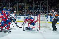KELOWNA, CANADA - FEBRUARY 17:  Dillon Dube #19 of the Kelowna Rockets looks for the pass in front of Todd Scott #35 of the Edmonton Oil Kings as he defends the net ahead of referee Reagan Vetter on February 17, 2018 at Prospera Place in Kelowna, British Columbia, Canada.  (Photo by Marissa Baecker/Shoot the Breeze)  *** Local Caption ***