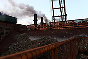 Sugarcane plants enter the mills as vapor steams out of the furnaces at LDC Biosev's Santa Elisa processing facility unity near Sertaozinho, Brazil, Friday, Aug. 24, 2012.  Brazil is on a quick path to become a global power. Rising economy, big infrastructure projects, an emerging and eager consuming middle class and the booming national industry are the evidences and consequences of the wealth in the southern nation. But the often hidden source of all this wealth falls far from the luring Rio beaches or the Kolkata-New York mix that Sao Paulo is. Behind texan hats and a similar attitude the countrymen display their power through a myriad of projects, festivals and behavior visually analyzed here.