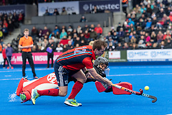 Hampstead & Westminster's Sam French sees his effort saved by Harry Gibson. Hampstead & Westminster v Surbiton - Men's Hockey League Final, Lee Valley Hockey & Tennis Centre, London, UK on 29 April 2018. Photo: Simon Parker