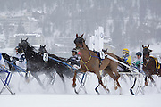 Trotting race at White Turf 2011 horse  racing event in St Moritz, Switzerland.