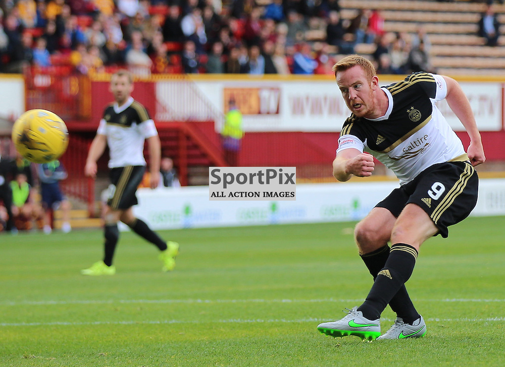 Motherwell v Aberdeen Scottish Premiership 15 August 2015; Adam Rooney (Aberdeen 9) shoots at goal during the Motherwell v Aberdeen Scottish Premiership match played at Fir Park Stadium, Edinburgh; <br /> <br /> &copy; Chris McCluskie | SportPix.org.uk
