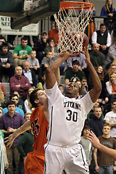 01 March 2014:  Eric Dortch gets hacked on the arm during a shot by Michael Berg during an NCAA mens division 3 CCIW  Championship basketball game between the Wheaton Thunder and the Illinois Wesleyan Titans in Shirk Center, Bloomington IL
