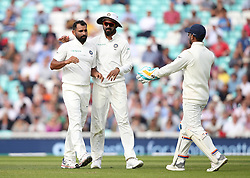 India's Mohammed Shami (left) celebrates taking the wicket of England's Ben Stokes during the test match at The Kia Oval, London.