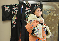 Viewing Assistant Eraena Valery models a mid 19th century fur-lined kimono from the Ching Dynastly in China in preparation for the rare whisky and Asian artifacts sales at Bonham's in Edinburgh this week.<br /> <br /> &copy; Dave Johnston/ EEm