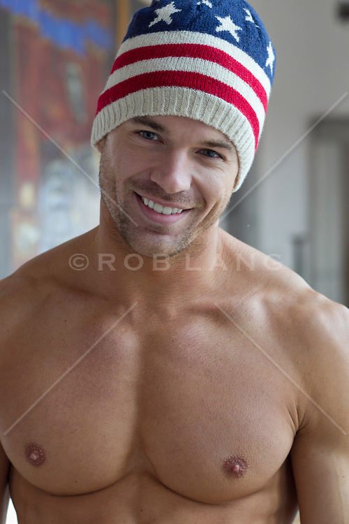 handsome shirtless man in an American Flag ski cap