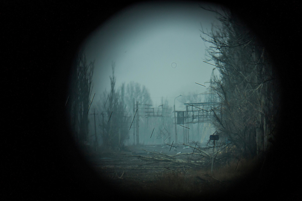 PIKSY, UKRAINE - NOVEMBER 19, 2014: A view of the front line as seen through a trench periscope in Pisky, Ukraine. The village of Pisky is the scene of much of the front-line fighting over the Donetsk airport. CREDIT: Brendan Hoffman for The New York Times