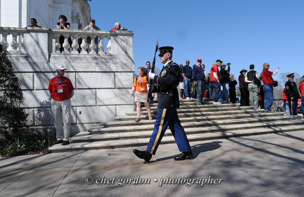 WWII Veterans and their escorts onboard the Hudson Valley Honor Flight view a Changing of the Guard ceremony at the Tomb of the Unknown Soldier at Arlington National Cemetery in Arlington, VA on Saturday, April 11, 2015. Nearly 100 Veterans from the Orange County (NY) region toured the WWII, Korean, Vietnam, and USMC War Memorials, as well as Arlington National Cemetery. Hudson Valley Honor Flight is a chapter of the Honor Flight Network, which provides free flights for WWII Veterans and tours of the WWII Memorial constructed in their honor, and other sites in the nation's capital.  © Chet Gordon for Hudson Valley Honor Flight
