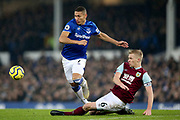 Burnley defender Ben Mee (6) gets the tackle on Everton forward Richarlison (7)  during the Premier League match between Everton and Burnley at Goodison Park, Liverpool, England on 26 December 2019.