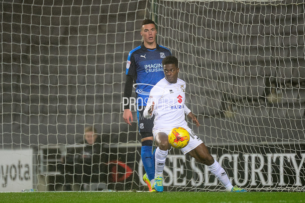 Milton Keynes Dons striker Kieran Agard (14) scores a goal from open play (1-0) during the EFL Sky Bet League 1 match between Milton Keynes Dons and Swindon Town at stadium:mk, Milton Keynes, England on 30 December 2016. Photo by Dennis Goodwin.
