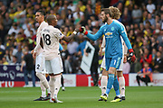 Manchester United Midfielder Ashley Young and Manchester United Goalkeeper David De Gea wish each other well punching fists before the Premier League match between Watford and Manchester United at Vicarage Road, Watford, England on 15 September 2018.