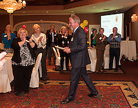 Jack Terrill receives a standing ovation of thanks from the United Way community during  a reception held Tuesday evening at Church Landing.  (Karen Bobotas/for the Laconia Daily Sun)