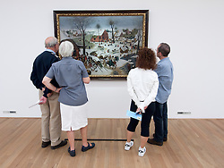 Visitors looking at Census at Bethlehem by Peter Brueghel the Younger at Bonnefanten Museum in Maastricht , Limburg , The Netherlands