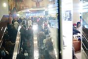 Travelers head up to the lobby and luggage claim area at Hartsfield-Jackson Atlanta International Airport in Atlanta, Georgia January 6, 2009.