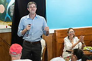 Democratic presidential hopeful Beto O'Rourke smiles after a vehicle with covered in Trump posters tried to interrupt his campaign stop at Gilligan's Restaurant April 13, 2019 in Summerville, South Carolina. During the event in the suburb of Charleston, Beto picked up the endorsement of South Carolina Rep. Marvin Pendarvis.