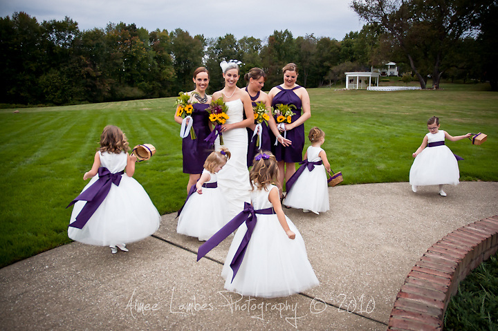 Bride and bridesmaids with dancing flower girls.