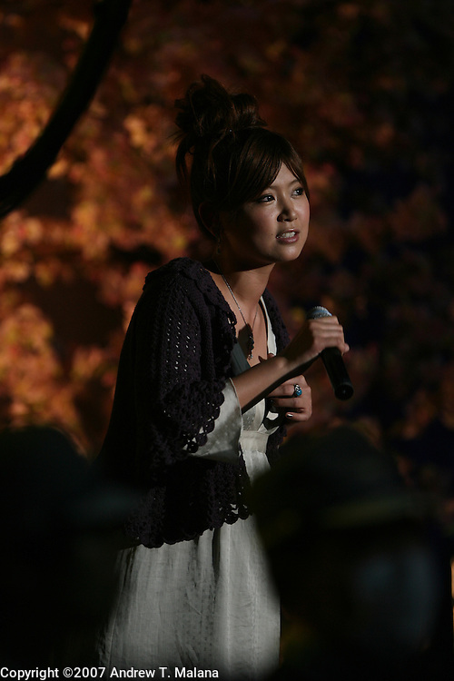 TOKYO - MARCH 25: Japanese Pop singer Ayaka sings live for Miki Ando of Japan in an exhibition program during at the World Figure Skating Championships at the Tokyo Gymnasium on March 25, 2007 in Tokyo, Japan. Ayaka sang two songs for her best friend Miki Ando. (Photo by Andrew T. Malana)..