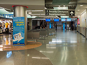 "17 MARCH 2020 - DES MOINES, IOWA:  The empty main hall at Des Moines International Airport Tuesday morning. Sunday night, the Governor announced that the state health department had recorded ""community spread"" in Des Moines. Tuesday, the Governor ordered all restaurants and bars to close or go to take out only. The Iowa Department of Public Health has urged all public buildings, like libraries and schools, to close, and all schools in Iowa are closed for at least 30 days.     PHOTO BY JACK KURTZ"