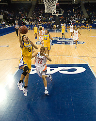 UCSB guard Jessica Wilson (5) shoots a layup past Virginia guard Britnee Millner (12).  The #4 seed/#24 ranked Virginia Cavaliers defeated the #13 seed Santa Barbara Gauchos 86-52 in the first round of the 2008 NCAA Division 1 Women's Basketball Championship at the Ted Constant Convocation Center in Norfolk, VA on March 23, 2008