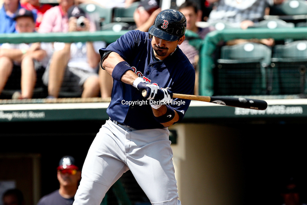 March 16, 2011; Lake Buena Vista, FL, USA; Boston Red Sox first baseman Adrian Gonzalez (28) during a spring training exhibition game against the Atlanta Braves at the Disney Wide World of Sports complex.  Mandatory Credit: Derick E. Hingle