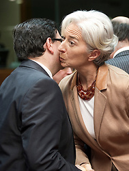 Christine Lagarde, France's finance minister, right, greets Tonio Fenech, Malta's finance minister, left, as they arrive for the emergency meeting of European Union finance ministers in Brussels, Belgium, on Sunday, May 9, 2010.  European Union finance ministers meet today to hammer out the details of an emergency fund to prevent a sovereign debt crisis from shattering confidence in the 11-year-old euro. (Photo © Jock Fistick)