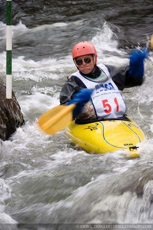 Chuck McHenry of Ironton, Missouri races in the K1 men's expert class during the slalom course of the 42nd Annual Missouri Whitewater Championships. McHenry placed first place in the class. The Missouri Whitewater Championships, held on the St. Francis River at the Millstream Gardens Conservation Area, is the oldest regional slalom race in the United States.